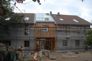 Rohputz mit Holzfassade